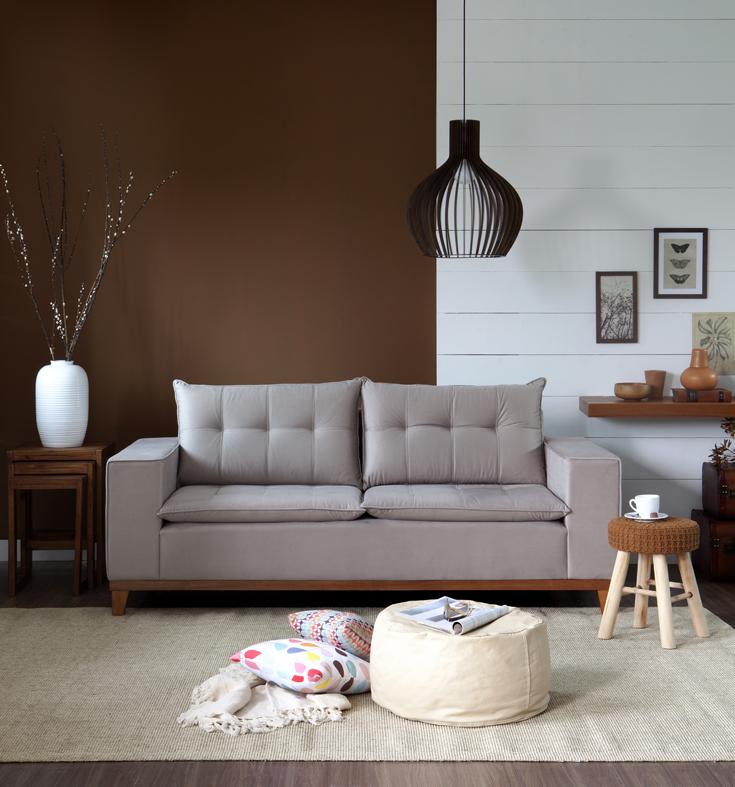 meia parede branca e marrom na sala de estar