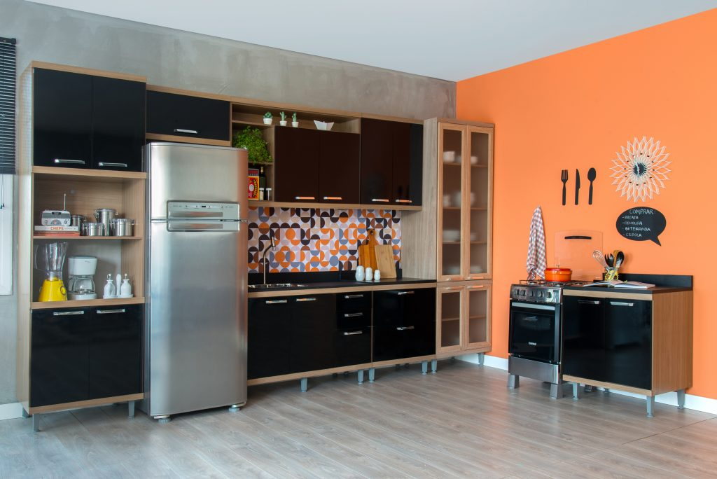 modern kitchen decor with black and orange and hanging details