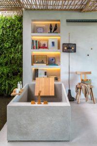 spa em casa com banheira de concreto