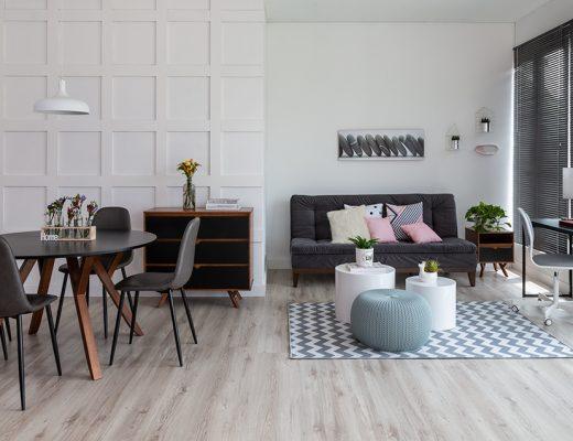 living room com estilo escandinavo e móveis pretos